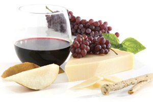 Photo of glass of wine, cheese and grapes.